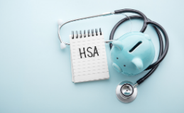 HSA notepad with piggy bank and stethoscope